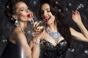 16673291 - happy laughing women drinking champagne, singing xmas song